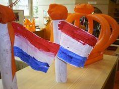 Vlag maken aan een keukenrol met een oranje bol erop