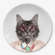 Wild Dining Cat Dinner Plate : Have your tea on the wild side, with this sweet cat dinner plate. Courtney the cat is just champing at the bit to be accessorized by your dinner and it doesn't always have to be a melon hat either! Let your imagination run wild and decorate this cool cat with food.  This plate looks great as part of our range of animal plates and mugs so go on, play with your food!