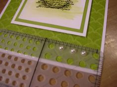 Do you ever have trouble getting your pearls or rhinestones spaced evenly? Here's a little trick - use your mat pack. The pearls and rhinestones fit perfectly inside the largest holes and you can get them lined up perfectly straight on your card.