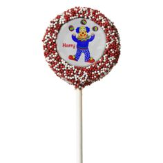 A fun and colorful personalized birthday cookie pops with a jolly circus clown, so cute and a favorite with young boys and girls alike; just customize it with your child's name or text of your choice.