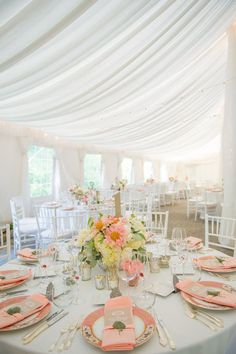Marquee wedding with peach coloured plates and decorations