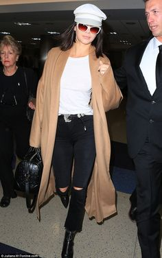 Model behavior: Kendall Jenner, 21, looked fashionable in white, sporting a chic newsboy cap and matching white-rimmed sunglasses as she touched down at LAX on Monday