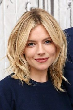 Sienna Miller mid length hair with waves.