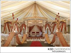 like this gold color and the simplicity of the red curtains against the white tent at the back of the mandap - overall a little overwhelming though
