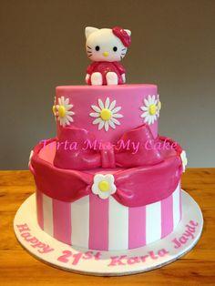A Hello Kitty themed cake for my niece's 21st birthday.Coconut cake top tier, caramel mud cake bottom tier.  by Torta Mia My Cake