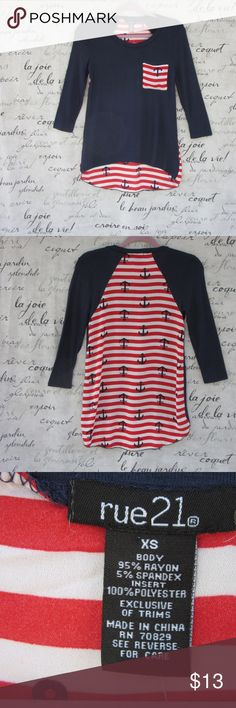 """Rue 21 Navy Blue & Red Mixed Media Top High-Low pullover of soft navy rayon/spandex blend. Back insert is 100% poly. Front pocket and back are red & white stripes with anchors. Front is 23 1/2"""" and back is 28 1/2"""".  NWT; never been worn. Rue 21 Tops"""