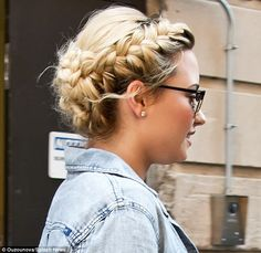 The mane event! Demi Lovato shows off Heidi-style plaits as she leaves hotel…
