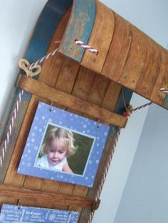 Are you a fan of winter activities? This Toboggan winter photo display is great for showing off your favorite photos.