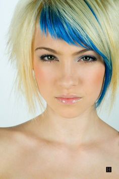 Blue Low-lights  This is a short layered hairstyle with blue low lights, a side part, and a sweeping bang. Finish with styling foam and a medium hold hair spray.