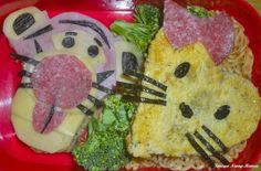 Tigger and a hello kitty shaped heart omelet.