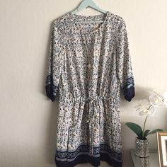 "Floral tunic or short dress ️️TRADES. Great spring piece. Floral tunic/dress. Dropped waist that gathers with two strings. Pleaded skirt, two front pockets, 3/4 length puff sleeve. Fully lined. I worn as a dress but also as a tunic over leggings. Will fit a 8-10 or M. Has no stretch approx measurements: 18"" shoulder to shoulder. 21"" across chest. Hip is 20"" across and dress length is 37"". Pre'd in excellent condition. Made of polyester Dresses Mini"