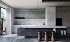 Industrial style interiors with dark decor. Featuring rustic stone decor, raw concrete interiors, designer furniture, marble decor, and ambient lighting ideas.
