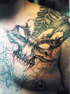 See more Devil's skull tattoos on shoulder and chest