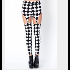 Diamond Black White Suspender Leggings NWOT brand is sold at Hot Topic.  Never been worn 4 left. Sexy n Fun leggings you'll love them Hot Topic Pants Leggings