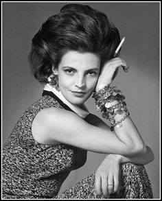 Princess Laudomia Hercolani wearing Valentino gypsy coin bracelet and earrings, and knit dress by Trico, photo Radkai, Vogue 1963