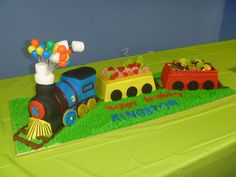 Train cake with candy and chocolate cargo for my little mans 3rd bday. by Serena Bartok