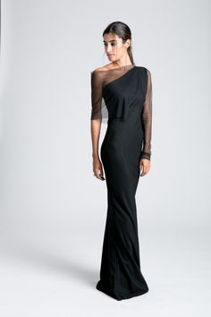 A sophisticated, evening gown with mesh sleeves, just perfect for any formal occasion. Its minimalist, figure flattering silhouette is enhanced by the second layer of mesh fabric. An absolutely stunning formal gown. Elegant Dresses Classy, Elegant Dresses For Women, Classy Dress, Beautiful Dresses, Black Formal Gown, Formal Gowns, Dress Formal, Dress Long, Long Evening Gowns