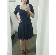 """Navy Blue H&M Dress Form-fitting cotton, navy blue dress. Size small, fits a size 6 (though it's a little snug). Fit is a little loose on me in the shoulders, so it looks a little awkward, ha. Knee-length for me (5'4""""). Worn about 10 times. Great condition; no signs of wear or tear. Mirror is dirty (sorry!); no stains or anything H&M Dresses Midi"""