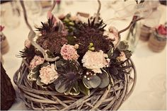 Rustic wedding flowers, table, image by Anna Clarke Photography