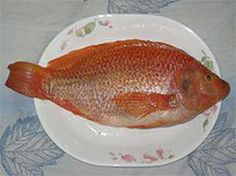 have never realized what Tilapia Fish looks like before it's cut up... kind of ugly!
