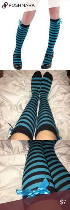 Black and Blue tall socks with bows Blue and black tall socks. I wore these socks once on halloween with a butterfly costume. They are in great condition. They are from Party city. I wear a size 8 women's shoe and they fit me so they would fit any size around a women's 8. Party City Accessories Hosiery & Socks