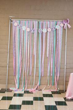 Ribbon backdrop at a Fairy 1st Birthday Party via Kara's Party Ideas | Kara'sPartyIdeas.com #fairyparty #partybackdrop #idea #party #fairy
