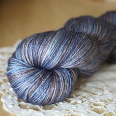"""One of a kind gorgeousness:  blues, greys, mauves and periwinkles, hand dyed in a super soft and silky merino/cashmere/silk.  Only two skeins exist in this colourway:  """"arctica.""""  Hand dyed by Phydeaux - just click through the photo for more details!"""