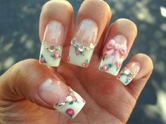 Long Rose Nails With Diamonds and a bow