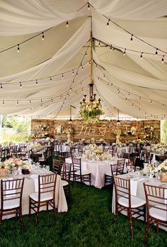 Beautiful Wedding Tent Ideas: Rustic Tent with Wooden Accents | Brides.com: