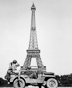 John Downey, Soldiers of US Infantry Division looking at the Eiffel Tower from their jeep, after they helped liberate the capital city during WWII, Paris, August Tour Eiffel, Paris Eiffel Tower, Eiffel Towers, Liberation Of Paris, Image Paris, 4th Infantry Division, History Online, American Soldiers, Off Road
