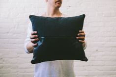 Leather and Canvas pillow by TJ Newell.