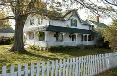 Anne of Green Gables. I would love to live in this house or one just like it with the white picket fence <3