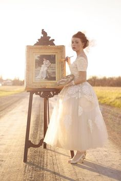 This makes me want to put my wedding dress on and paint.  Why not?