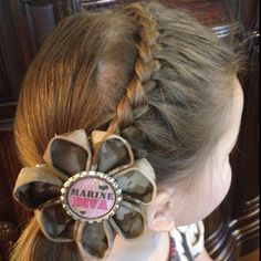 A one sided French braid from one side of the head to the other, then pull all hair into a side pony. So adorable and fairly easy and quick!