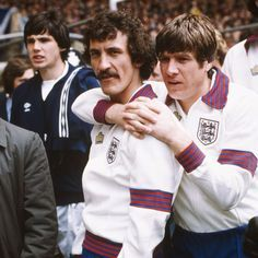 24th May 1980. Liverpool midfield player Terry McDermott is joined in the colours of England by his former captain Emlyn Hughes while next to him in the Scotland track suit was his replacement Alan Hansen