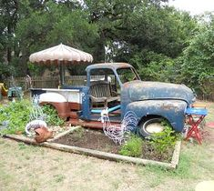 "Re purposed Truck  1953 Chevy truck is now my grand kids ""playscape"" Some days it is a pirate ship others it is a garbage truck. Sometimes we just sit on the bench in the cab and go to the beach. Our Bar-B-Que pit is under the hood. Wooden step up into the back bed. We love it."