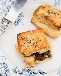 Black Pepper Biscuits with Bourbon-Molasses Butter Recipe on Food & Wine   Bobby Flay's tender, peppery biscuits are incredibly good on their own, but do as Bobby Flay does and serve them with his richly flavored molasses butter.