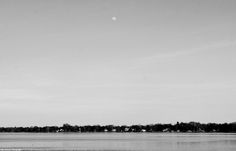 Waxing gibbous over the Delaware River in monochrome.