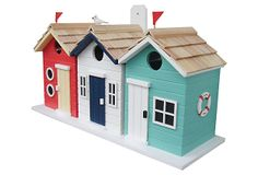 "BIRD HOUSE – 17"" Brighton Beach Hut Birdhouse. Surfs Up! These colorful beach cabanas are fully functional, triple bird nest boxes with seaside style. Each of the three birdhouses has its own clean-out and a mounting peg on the back allows for easy installation. A tiny seagull and two flag decorations are included."