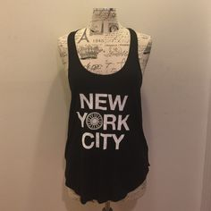 NYC SOULCYCLE SHIRT NWT Soulcycle NYC racerback Shirttail Tank . 100% cotton. 100% Algodon. New With Tags . Never worn . NO TRADE.NO TRADES. NO LOWBALL OFFERS . Continuous lowball offers will be blocked . Tops