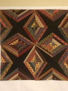 DK: 4 blocks completed of the Diamonds Are Forever string quilt.