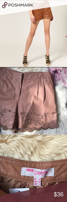 """ASOS Leather Laser Cut Shorts Fully lined and zip with hook and eye closure. In excellent condition. Real leather with pleats and pockets. 14.25"""" waist, 10"""" rise and 3.5"""" inseam ASOS Petite Shorts"""