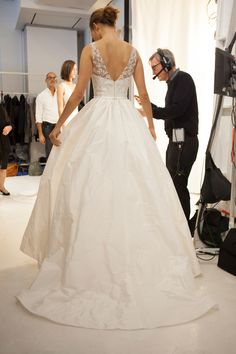 "A model awaits her turn at the Amsale Fall 2015 show to debut the ""Bardot"" taffeta ballgown with its hand beaded bodice."