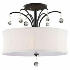 """5-light black chandelier with an hourglass shade and crystal drops. Product: ChandelierConstruction Material: Metal and glassFinish: BlackFeatures:  Adorned with silver metal and crystalsWhite shade Accommodates: (5) 60 Watt E12 bulb - not includedDimensions: 11"""" H x 20"""" Diameter"""