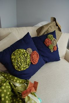 Gorgeous rosette pillow!  Love the bright colors! #pillow #rosette
