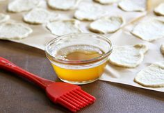 Brush dough discs with melted butter.