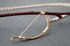 archery bow necklace by MisoPretty