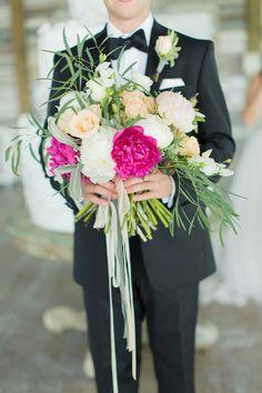 bouquet with a pop of fuchsia, photo by Jackie Ray Photography http://ruffledblog.com/texas-backyard-wedding-ideas #weddingbouquet #flowers