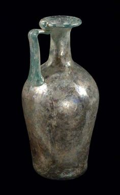 Roman Glass Pitcher Late III - Early IV Century A. D. Light turquoise, transparent, medium thin.