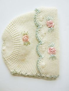 A Soft Cream Knit Baby's Hat With Pink Satin Flower Knots and Aqua Satin Crocheted Edges - Beautiful Knit Patterning - Warm Hat